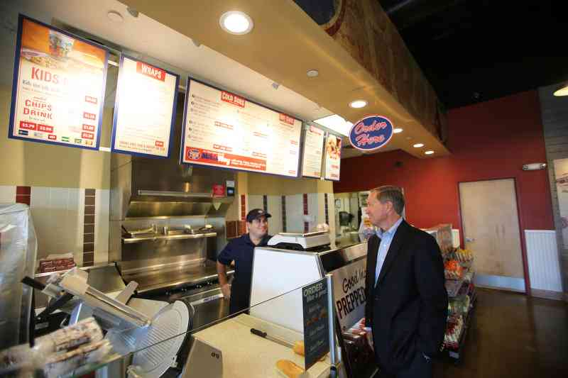 Jersey Mike's Subs President Hoyt Jones (right) talks with employee Kevin Loughran inside the chain's Red Bank, NJ location Oct. 31, 2016.