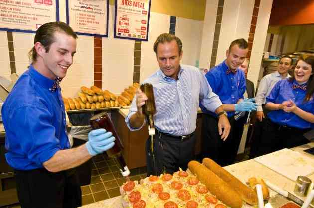 Jersey Mike's CEO Peter Cancro (center) and employees