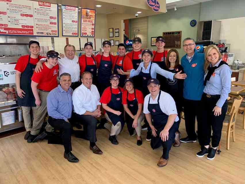 Jersey Mike's Founder Peter Cancro (kneeling, 2nd from L) celebrated Day of Giving in Northridge, CA