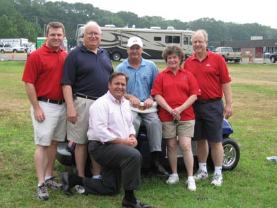 Left to right: Bryan Haltigan, The First Tee; Tom Coyle, The First Tee; Dennis Walters, professional golfer; Pat Coyle, volunteer; Bob Hodnett, First Tee; and Peter Cancro, Jersey Mike's, on knee.