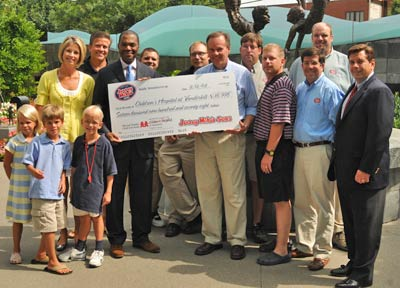 Area franchisees join in on check presentation