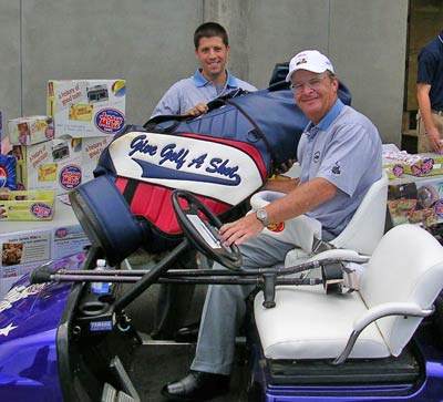 Dennis Walters (in cart) with assistant Nathaniel