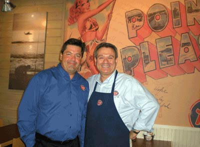 Shown here at the grand opening are from left to right: Dan Burell, Area Director and fellow Jersey Mike's Franchisee with Lloyd Weintraub, in his new restaurant.