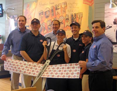 The Jersey Mike's Subs team gathers at the April 14 ribbon cutting at the company's first sub shop to open in the state in Vernon Hills.  More Chicago area stores are planned including one opening in Gurnee in May.  Jersey Mike's is holding a job fair on April 30 to fill an immediate 20 positions and is offering the first 100 applicants a coupon for a free regular sub.