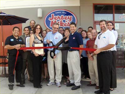 Franchisee Lloyd Weintraub is holding the scissors, to his left wife Sherry and next to her, manager Rich Vitolo.