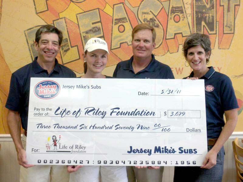 Shown, left to right: Bill Schulte, Jersey Mike's Subs Sarasota Franchisee, Kelly and Ron Saba of the Life of Riley Foundation, and Kathleen Schulte.