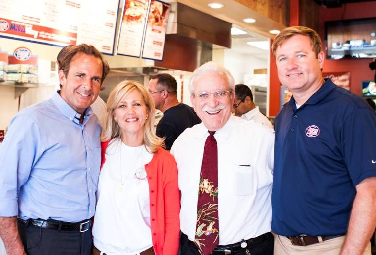 "Peter Cancro, Jersey Mike's founder and CEO, with Roberta Jurney, Executive Director, Quantum House; Carl Minardo, CFRE, Treasurer Max Planck Florida Foundation and Quantum House board member; and Jersey Mike's area director Greg McMenaman on ""Day of Giving"" in Jupiter, Fla."