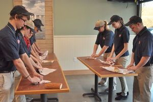 Employees at Jersey Mike's practice their wrapping technique on Friday evening. The new eatery is located at the Morganton Heights Shopping Center and will open Wednesday.