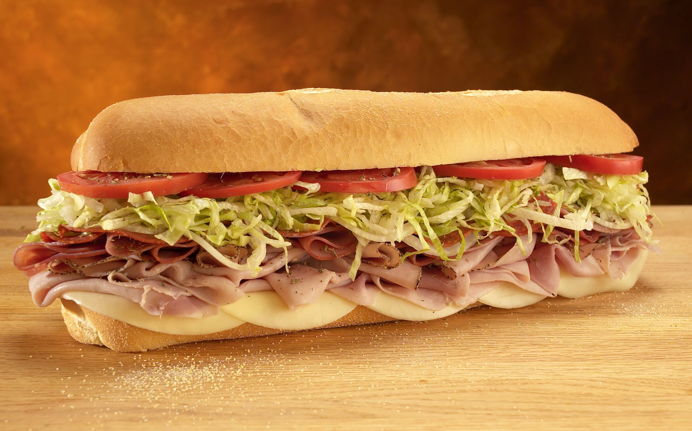 "The Original Italian (provolone, ham, prosciuttini, cappacuolo, salami and pepperoni) served Mike's Way with onions, lettuce and tomatoes and topped off with an exquisite zing of ""the juice"" - blended red wine vinegar and olive oil."